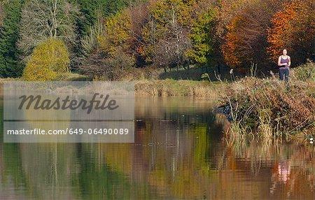 Rural landscape reflected in still lake