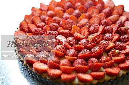 Making  a Strawberry tart in a baking tin