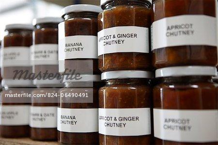 Various jars of chutney on a shelf - making chutney - step shot