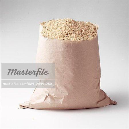 Brown paper bag full of brown rice