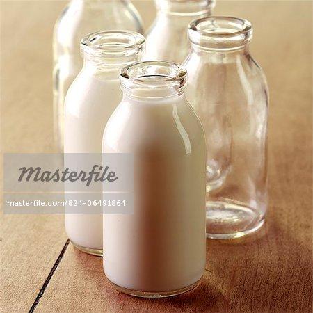 Full and Empty Milk Bottles