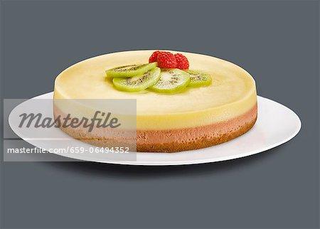 Whole Raspberry Lemon Cheesecake with Kiwi and Raspberry Garnish