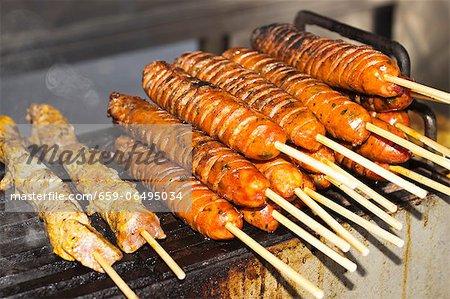 Pork and Chorizo Kabobs on a Food Cart