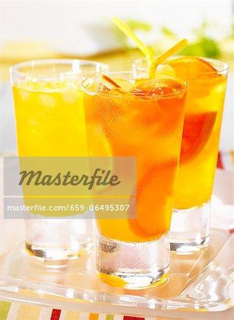 Three tangerine and grapefruit drinks