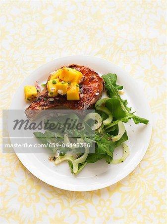 A pork chops with mango salsa