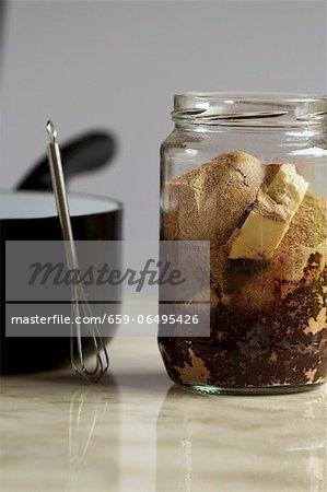 A jar of ingredients for vegan chocolate