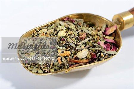 Herbal tea on a brass scoop
