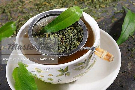 Ramson tea with a tea strainer