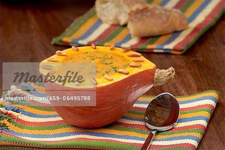 Pumpkin soup served in a hollowed out pumpkin