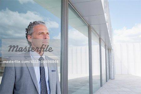 Pensive businessman outside building
