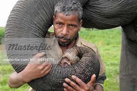 A mahout with his pet elephant, Kaziranga, Assam, India, Asia