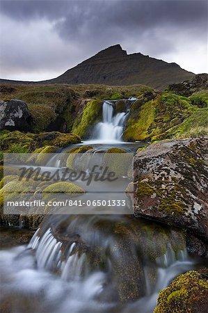 Rocky stream with waterfalls below Slaettaratindur mountain, Eysturoy, Faroe Islands, Denmark, Europe