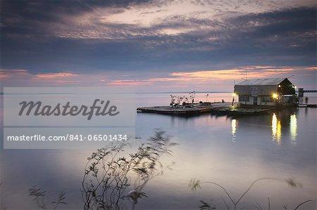 Boat landing moored on Rio Negro at sunset, Manaus, Amazonas, Brazil, South America