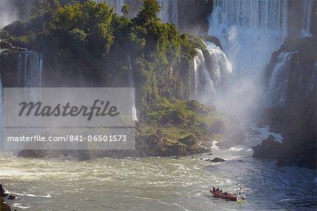 Tourist boat approaching Argentinean side of Iguacu Falls, Iguacu National Park, UNESCO World Heritage Site, Parana, Brazil, South America