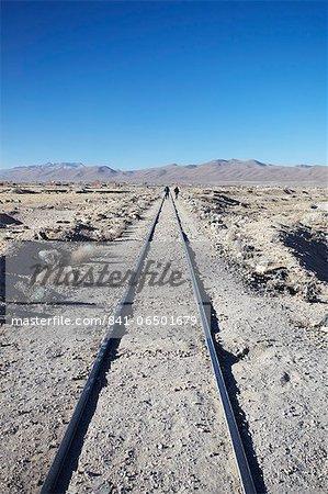 People walking along train tracks, Uyuni, Potosi Department, Bolivia, South America