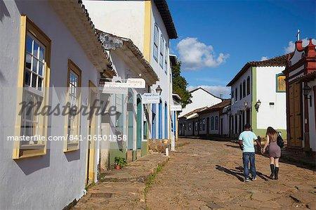 Couple walking along street, Tiradentes, Minas Gerais, Brazil, South America
