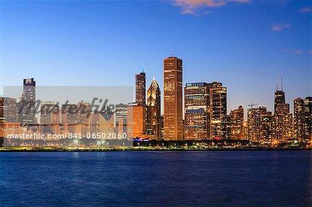 Chicago skyline and Lake Michigan at dusk, Chicago, Illinois, United States of America, North America