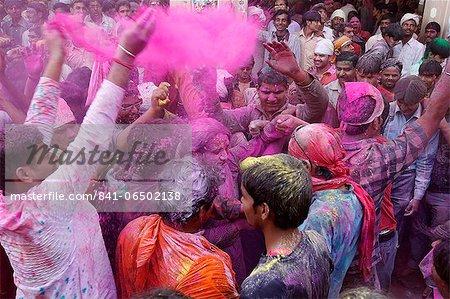 Dancers celebrating Holi festival in Barsana temple, Barsana, Uttar Pradesh, India, Asia