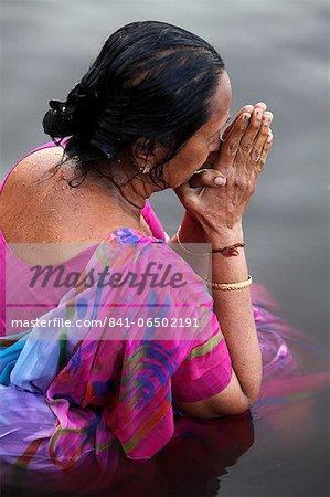 Hindu woman praying in the Yamuna River, Mathura, Uttar Pradesh, India, Asia