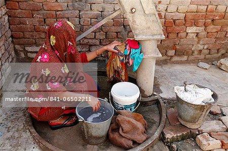 Woman doing laundry, Mathura, Uttar Pradesh, India, Asia