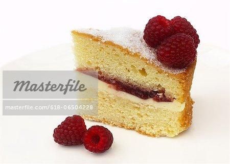 Tempting slice of Victoria sponge with raspberries