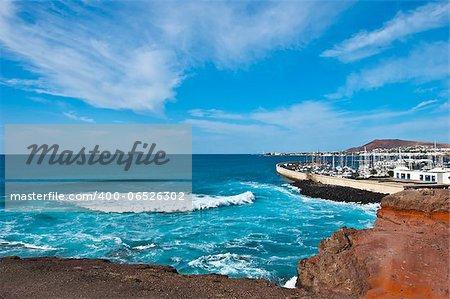 The Atlantic breaking on the coastline near Playa Blanca Lanzarote