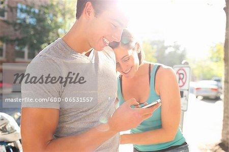 Couple Outdoors, Man using Cell Phone, Portland, Oregon, USA