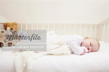 Baby girl sleeping in crib