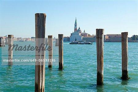 Wooden posts in urban harbor