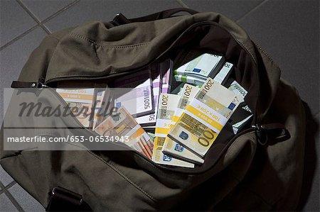 A bag full of large billed Euro banknotes