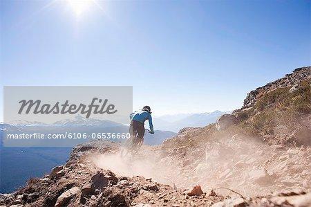 mountain biker riding on alpine trail
