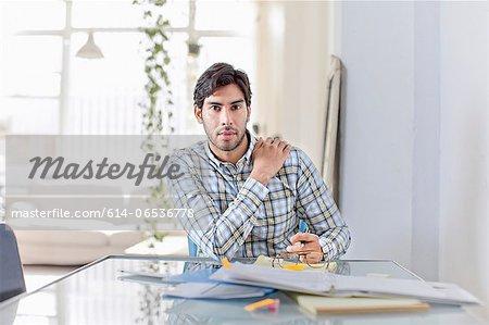 Businessman at work in kitchen