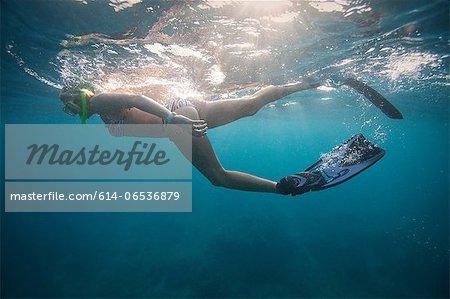 Woman snorkeling in tropical water