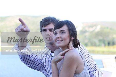 Couple admiring scenery outdoors