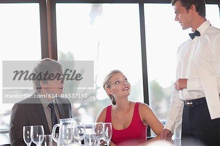 Couple having dinner at restaurant