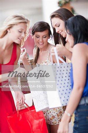 Women looking in shopping bags