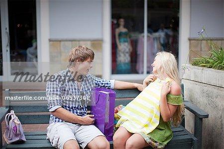 Man admiring girlfriend's shopping