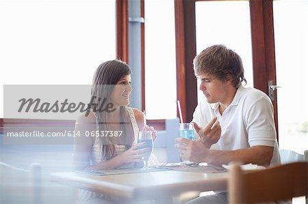 Couple having cocktails in restaurant