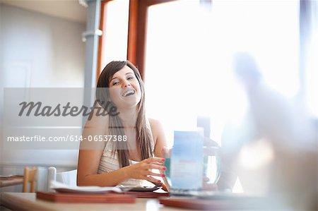 Woman having cocktail in restaurant
