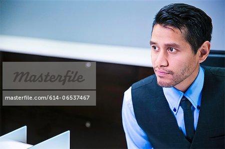Salesman sitting behind counter