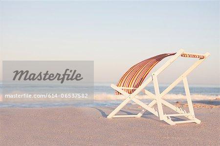 Lawn chair on empty beach