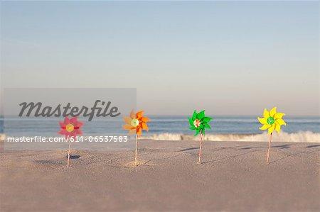 Pinwheels on empty beach
