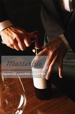 Sommelier opening a bottle of wine