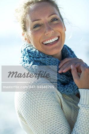 Beautiful mature woman standing on beach