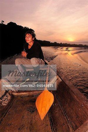 Man in dugout canoe on the Lago de Tarapoto, Amazon River, near Puerto Narino, Colombia