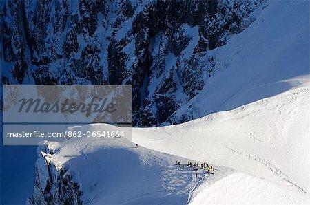 Europe, France, French Alps, Haute Savoie, Chamonix, Aiguille du Midi, skiers on the Vallee Blanche off piste ridge