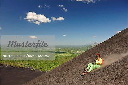 Tourist Surfing down Volcan Cerro Negro, Leon, Nicaragua, Central America