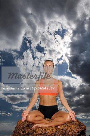 Woman meditating at the Aqua Wellness Resort,Pacific Coast, Nicaragua,Central America