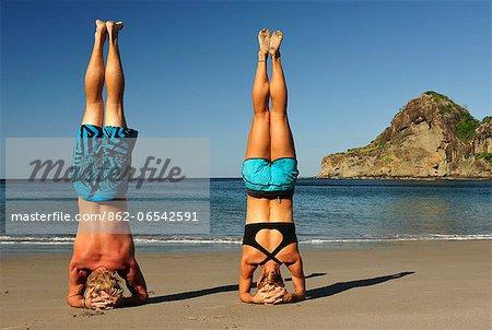 Couple doing yoga at the Aqua Wellness Resort, Nicaragua,Central America