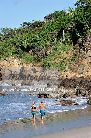 Couple walking on beach at the Aqua Wellness Resort, Nicaragua, Central America